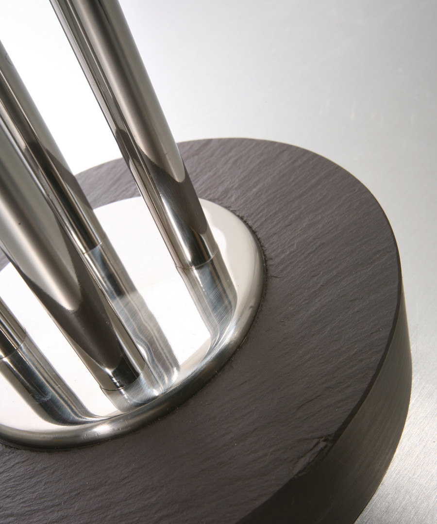 Naxos table light, detail shot of table lamp, welsh slate base and polished stainless steel columns - Chad Lighting