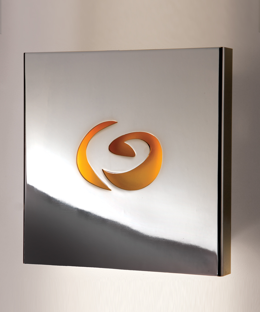Chicago wall light, in chrome, casting light up and down spilling light through yellow patterned centre - Chad Lighting