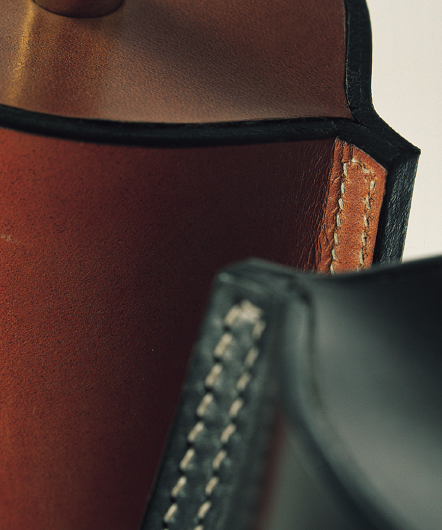 Cordoba table light, close-up detail shot of table lamps in Leather - warm tan and dark tan - Chad Lighting