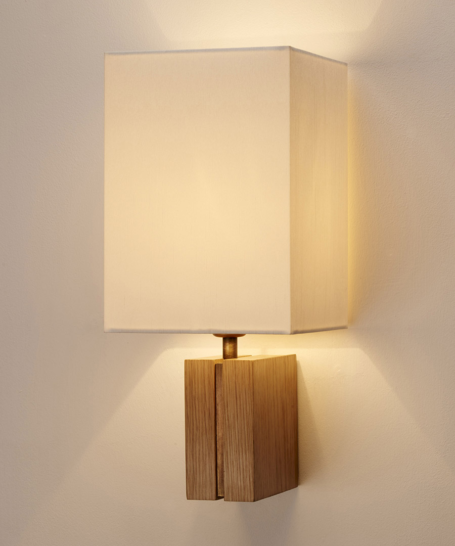Panino wall light, featuring oak and antique brass with a tall ivory shade - Chad Lighting