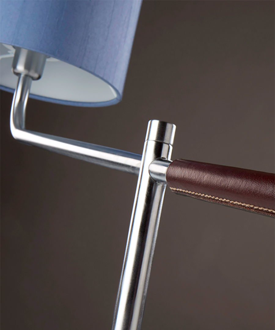 Riga table light, close-up of task light in brushed chrome and leather handle with a blue shade - Chad Lighting