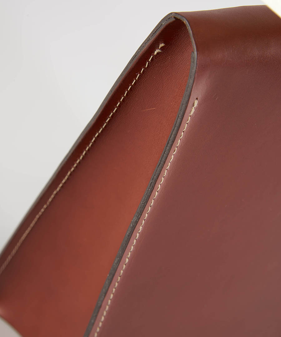 Satchel table light, close-up of warm tan leather table lamp - top - Chad Lighting